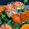 Panier fleuri dans les teintes orangées. Des Lys & Délices, Sion